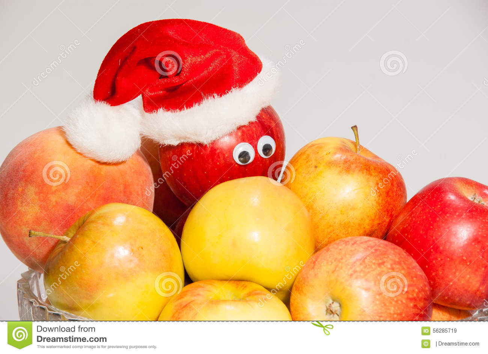 Vase En Verre De Fruits Avec Les Boites Et Le Chapeau De Noel Image