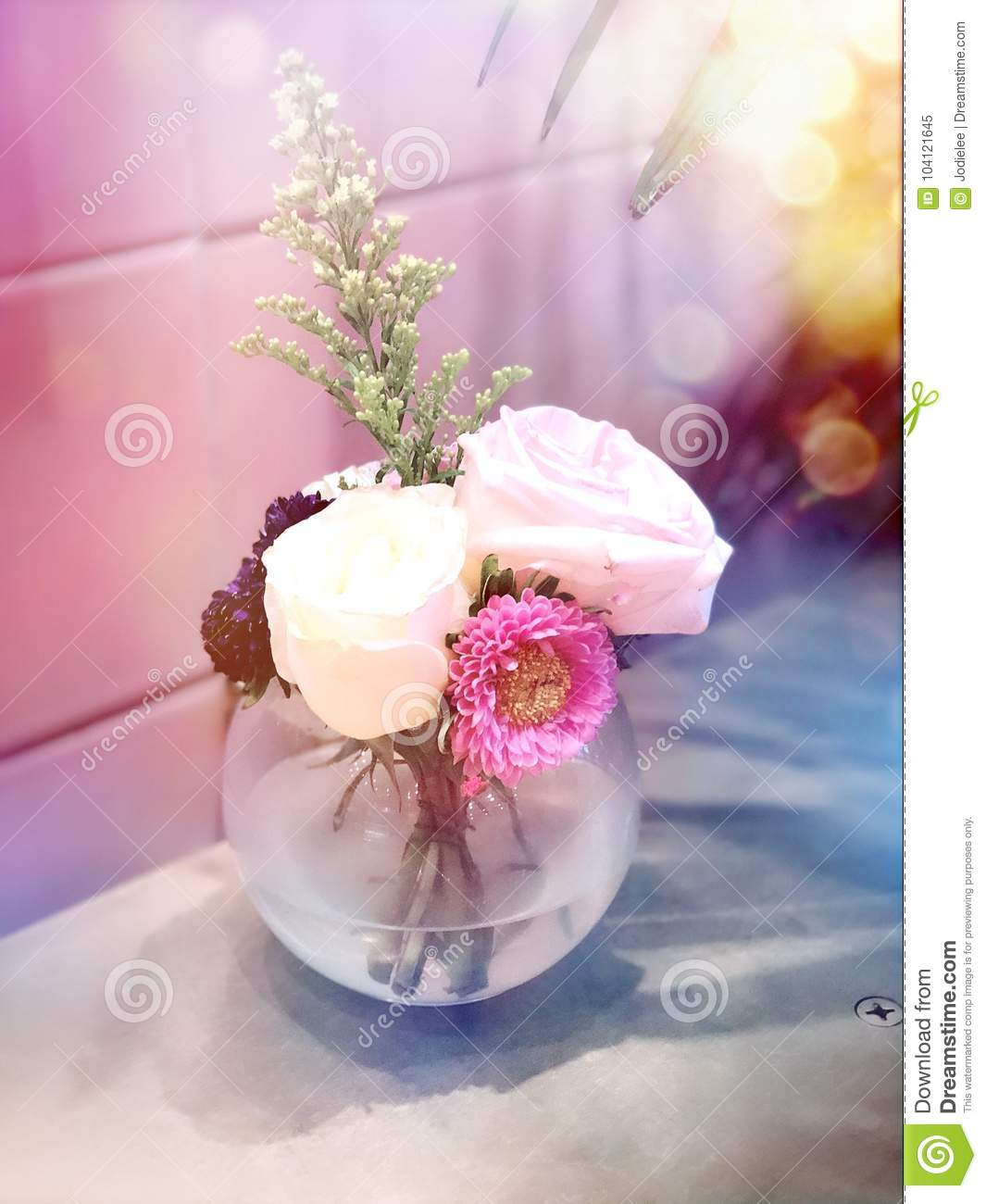 Vase With Pretty Flowers In The Sunlight With Bokeh Stock Image