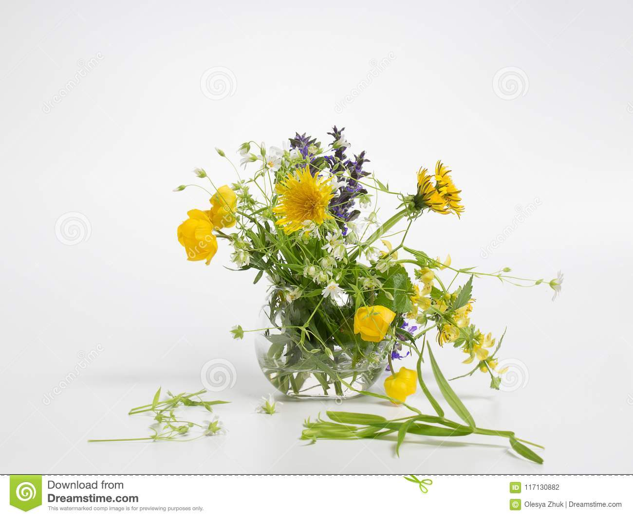 Vase With Spring Field Flowers On A Gray Background Yellow And