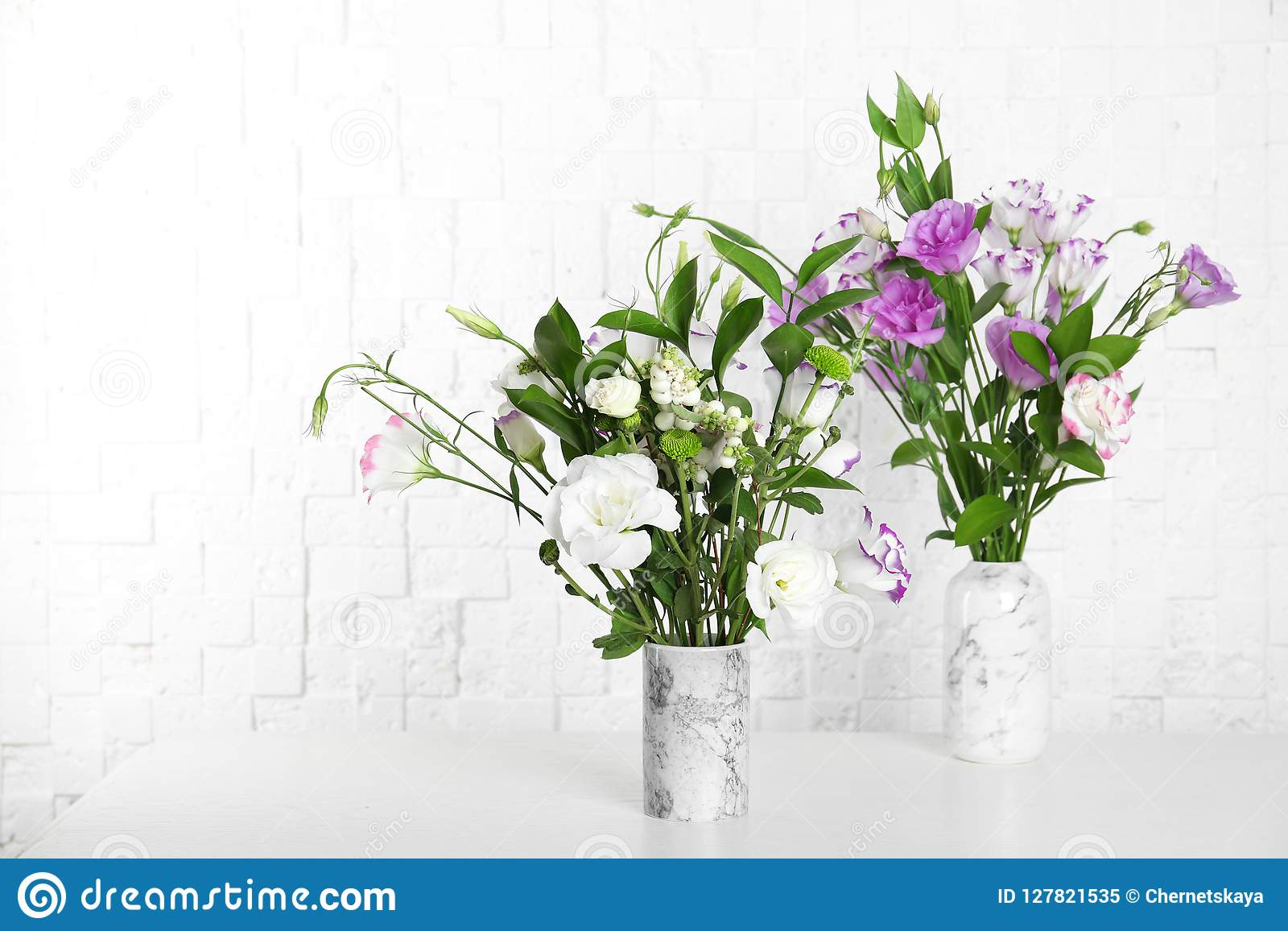 Vases with beautiful flowers on table stock image image of aroma vases with beautiful flowers on table izmirmasajfo