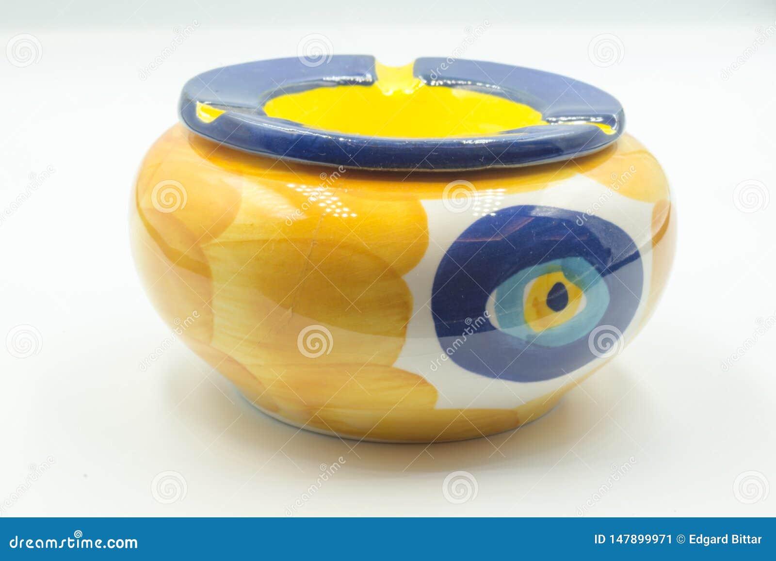 Vaso cerâmico amarelo e azul