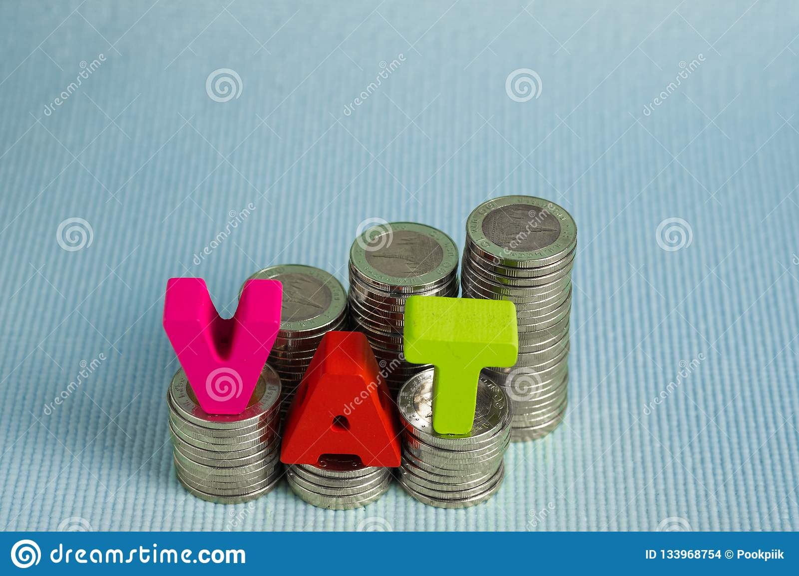 VAT Value Added Tax concept. Word VAT alphabet made from wood
