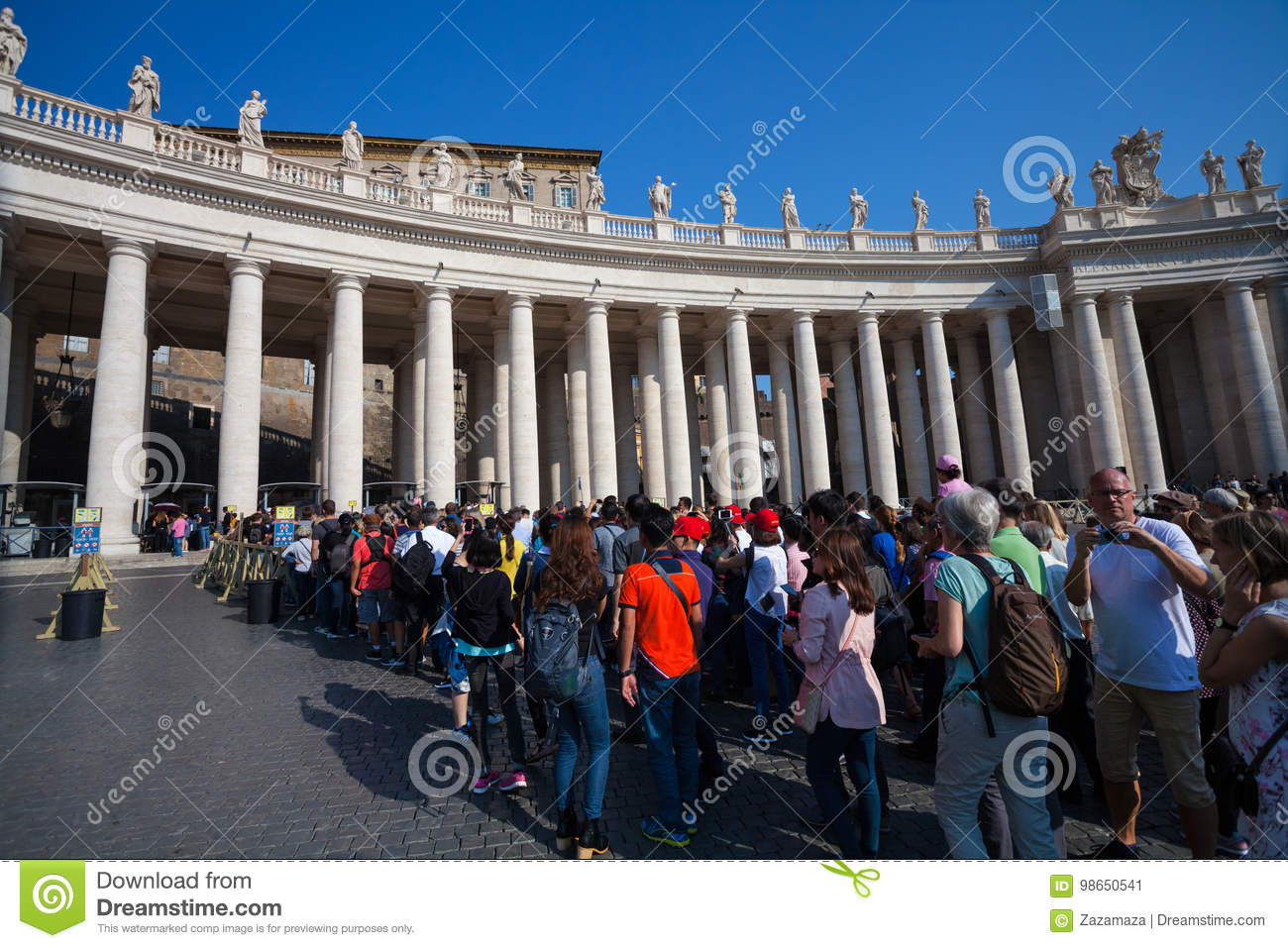 VATICAN CITY, VATICAN - September 13, 2016: Waitng tourists in queue who want to visit the St. Peter`s Basilica
