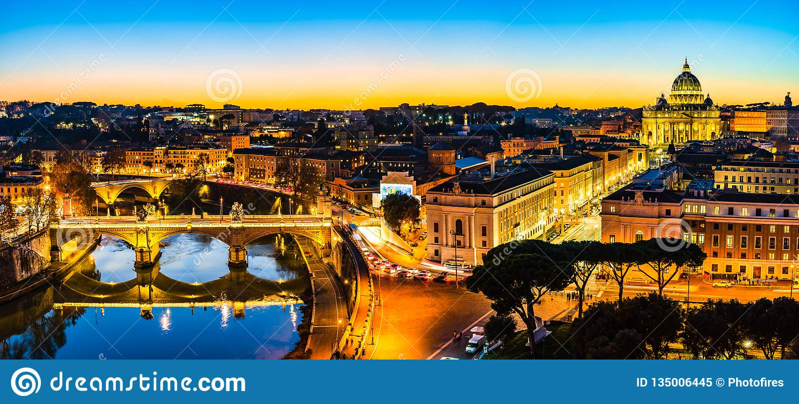 Night View Of St. Peter's Basilica And The Tiber River In