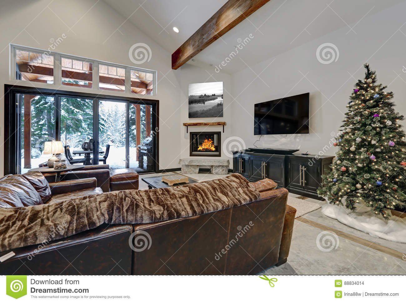 Vaulted Ceiling Living Room With Glass Sliding Doors To A Patio