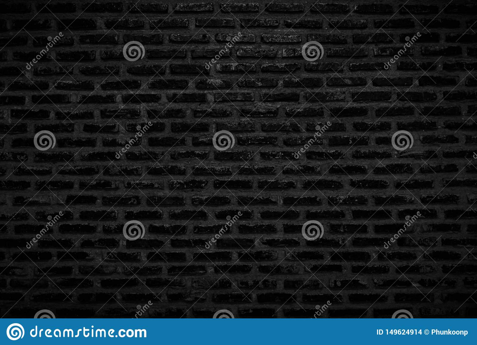 Vecchi struttura nera scura e fondo del muro di mattoni