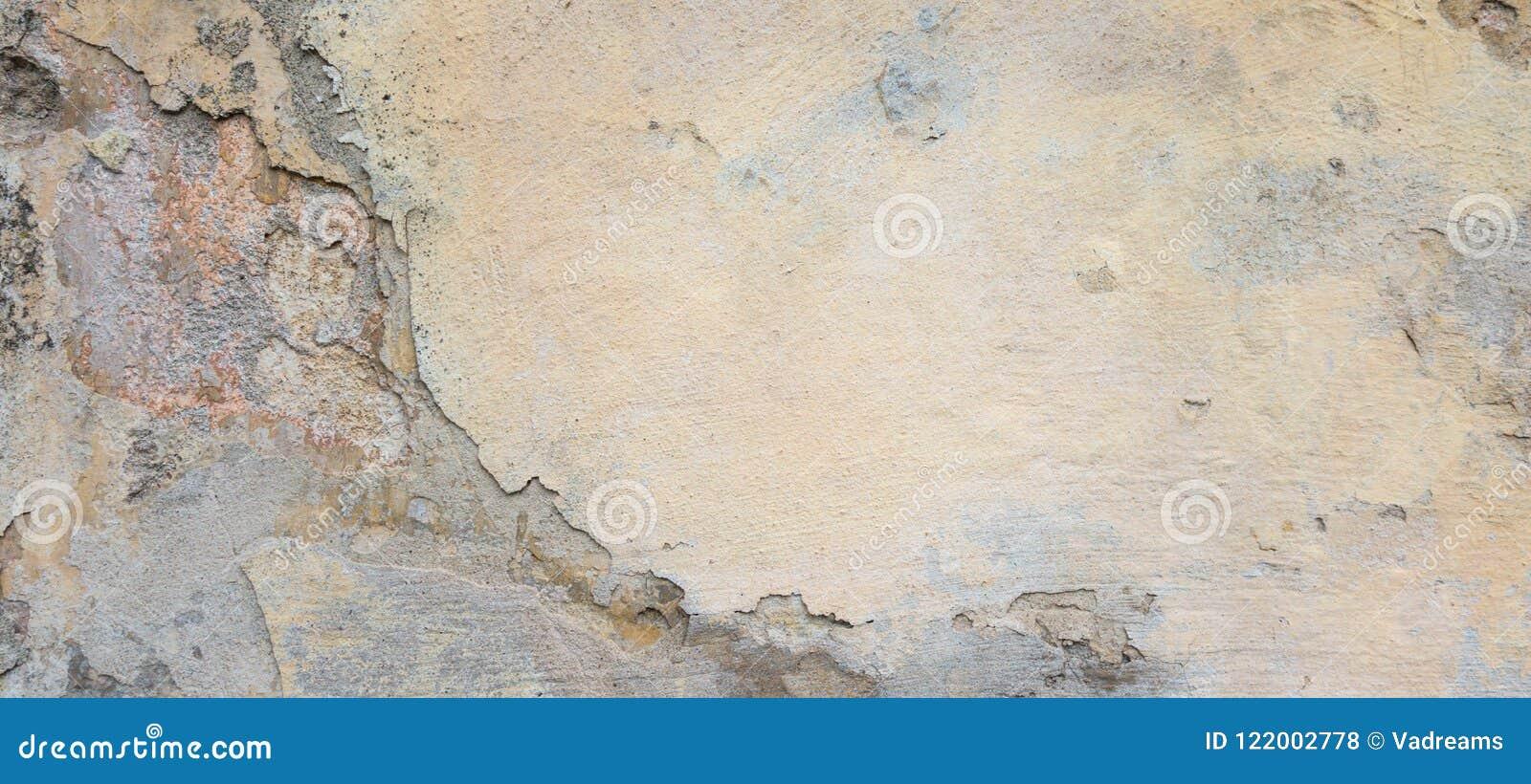 Vecchia parete del gesso con buccia grey stucco texture background