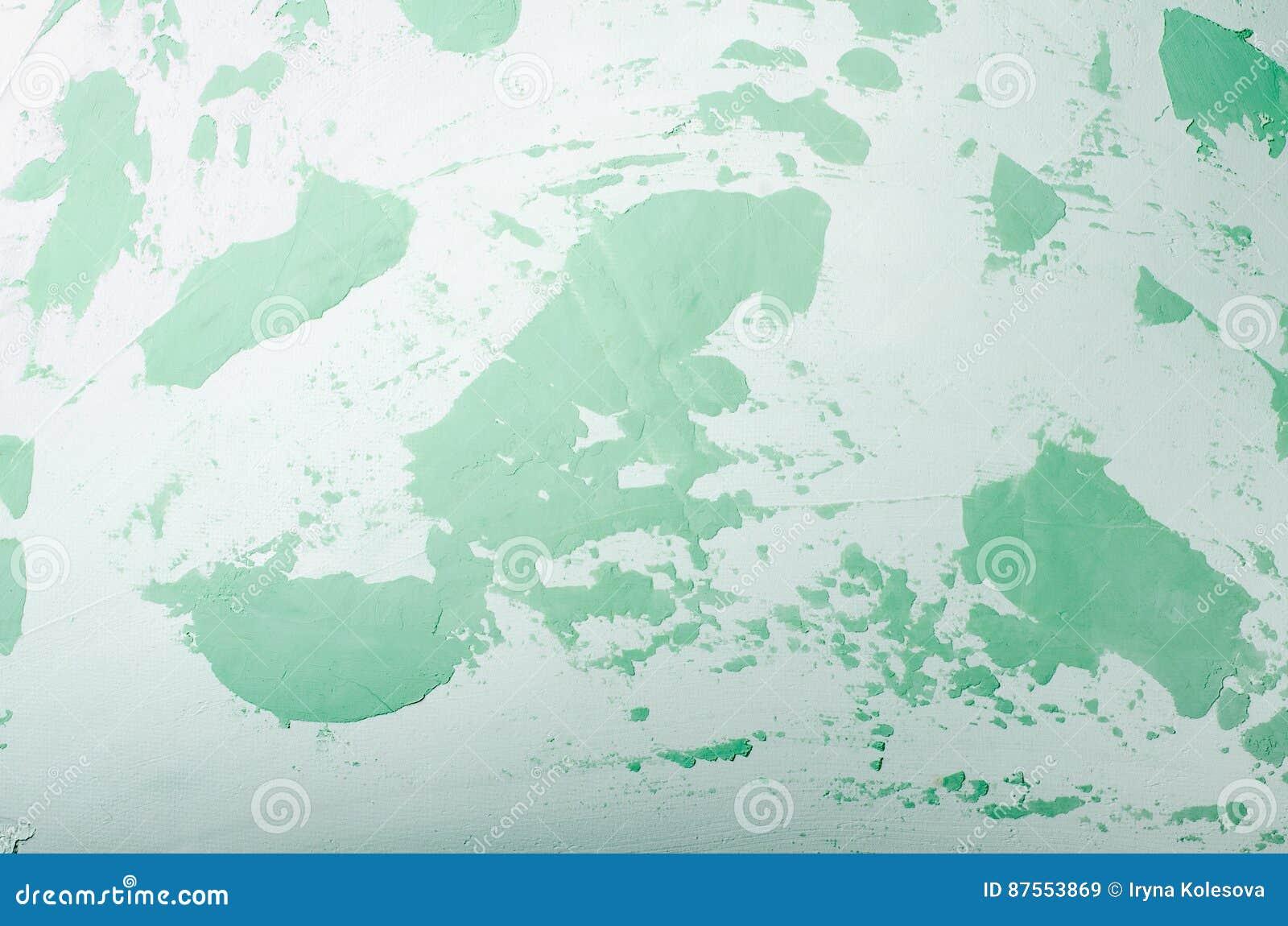 Vecchia parete incrinata nociva della pittura, fondo di lerciume, colore pastello verde