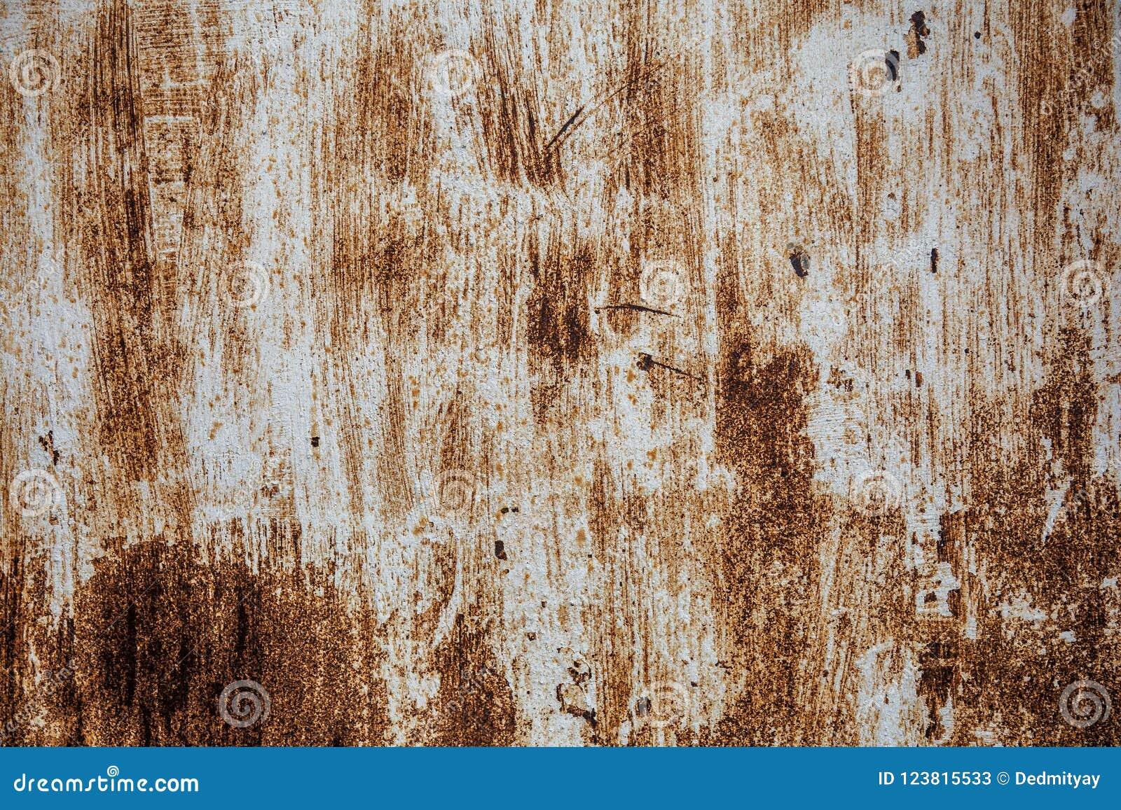 Vecchia struttura arrugginita del ferro, pittura graffiata su superficie metallica, strato di lerciume di metallo ruvido