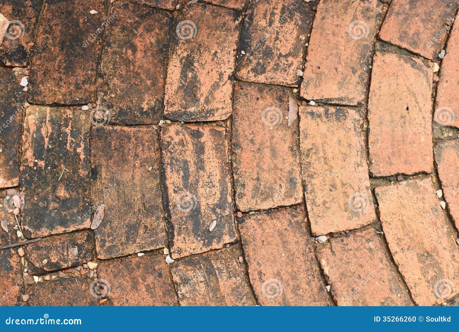 Vecchio mattone come piastrella per pavimento fotografia stock