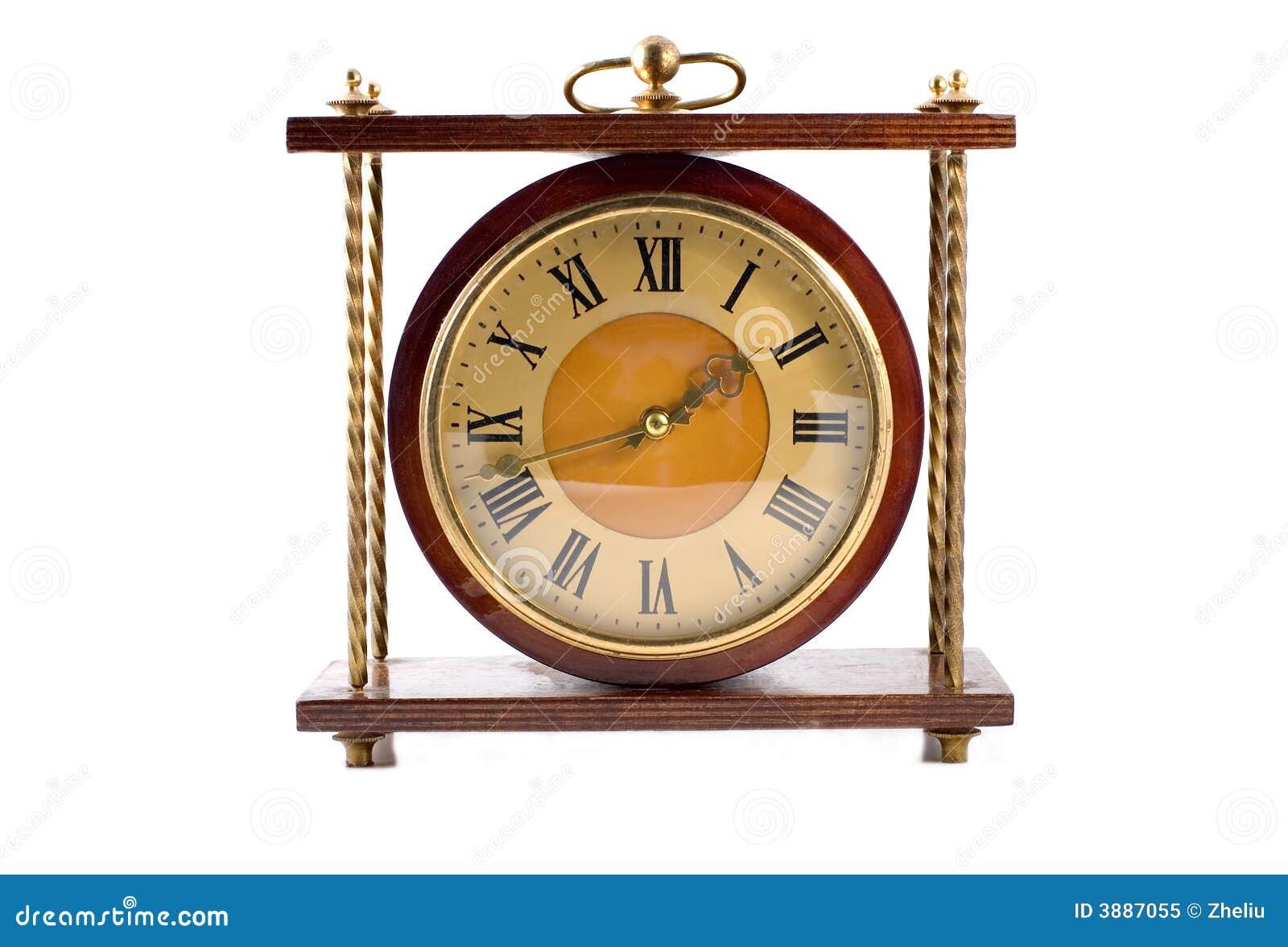 Vecchio orologio isolato su bianco