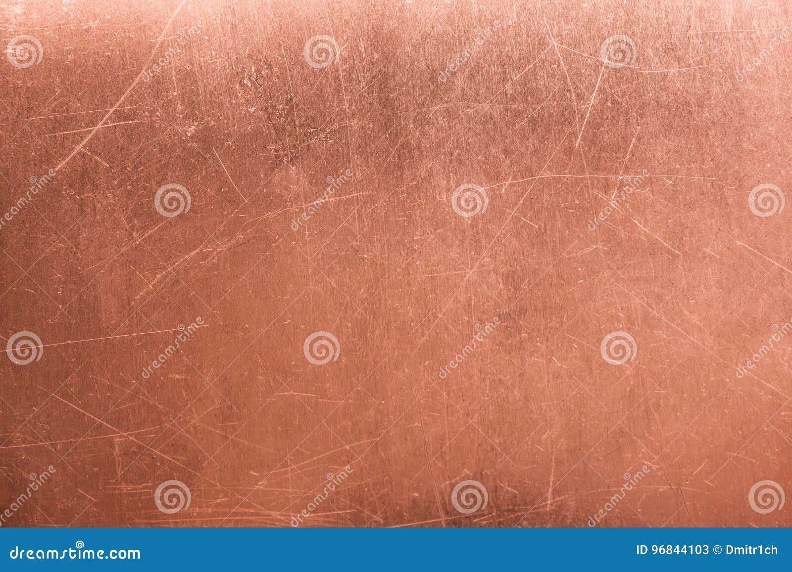 Vecchio rame di piastra metallica e spazzolato di struttura, fondo bronzeo