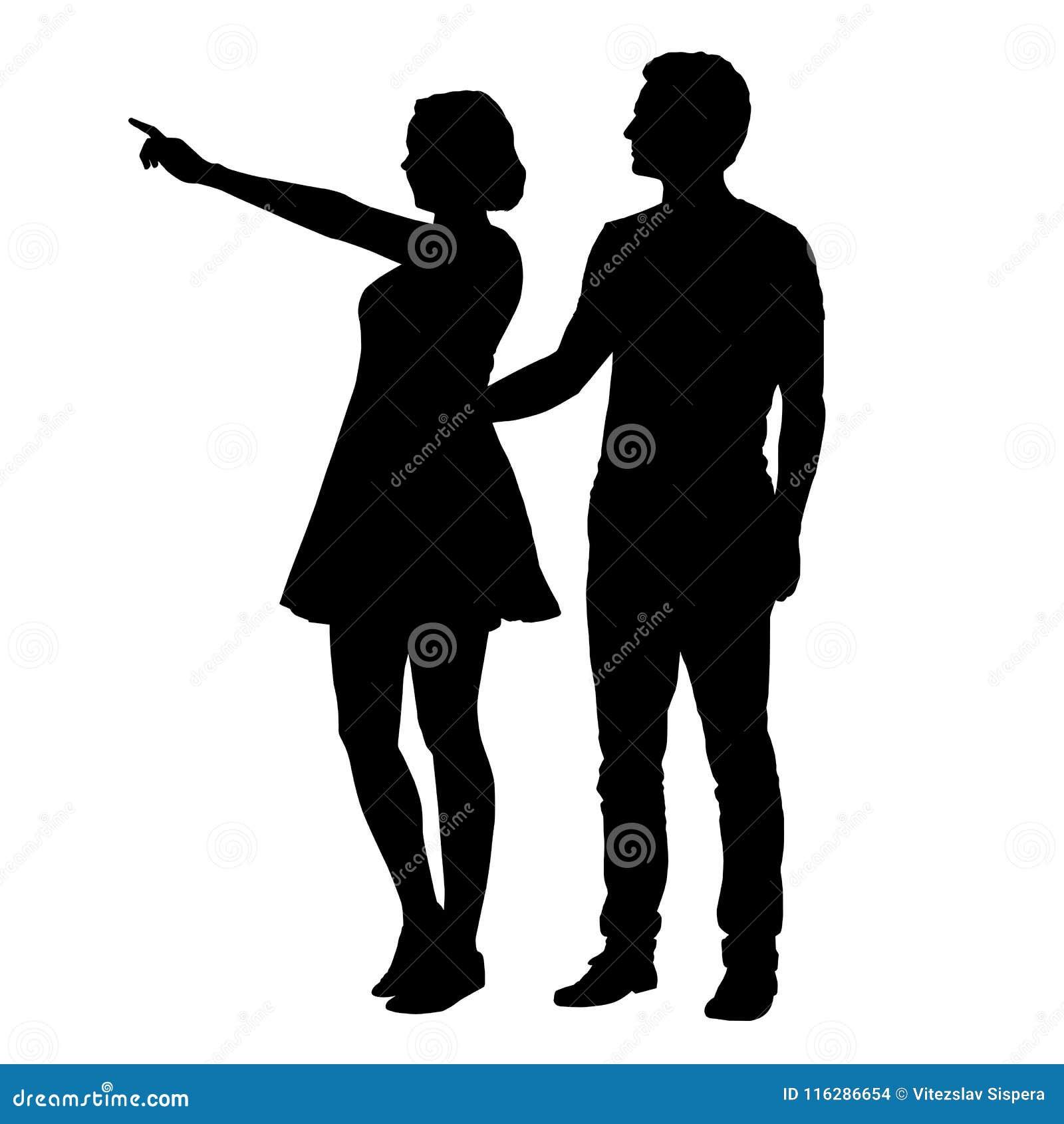 Vector la siluetta del ragazzo e della ragazza che stanno insieme e che indicano