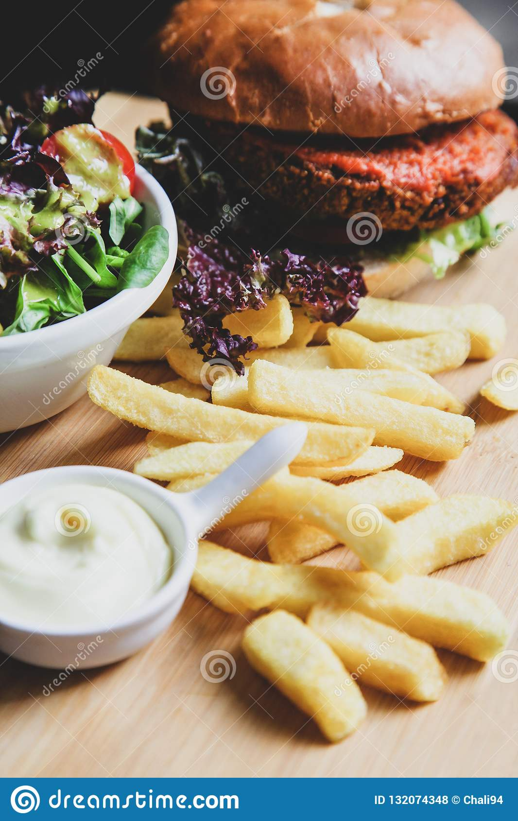 Vegan burger with salad, and french fries