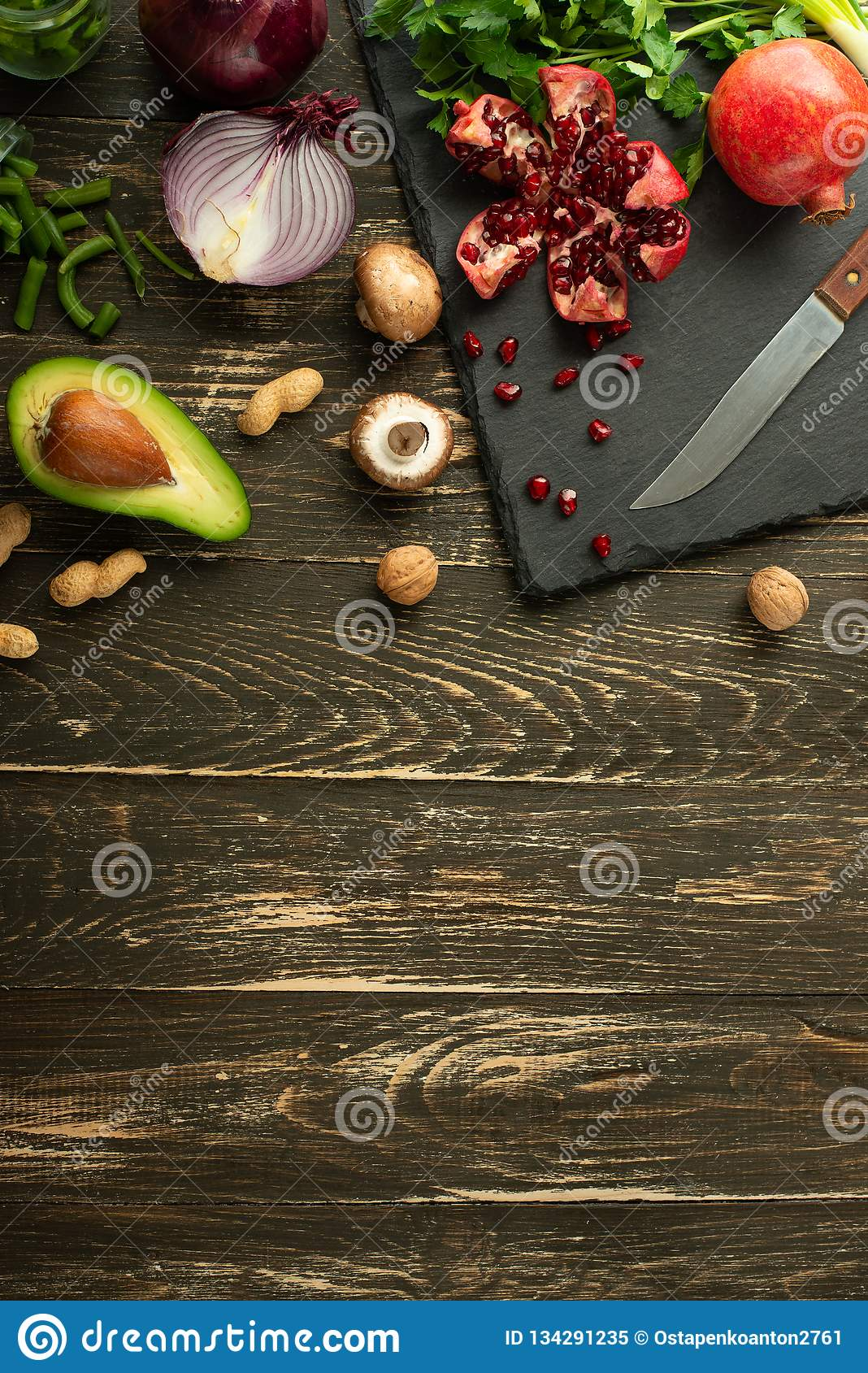 Vegan food, detox, avocado, fruit, green beans, broccoli, nuts and mushrooms. Diet and healthy food, vitamins and sports. Flat-lay