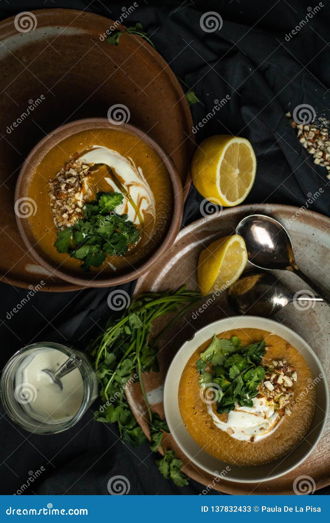 Vegan lentils soup in chiaroscuro