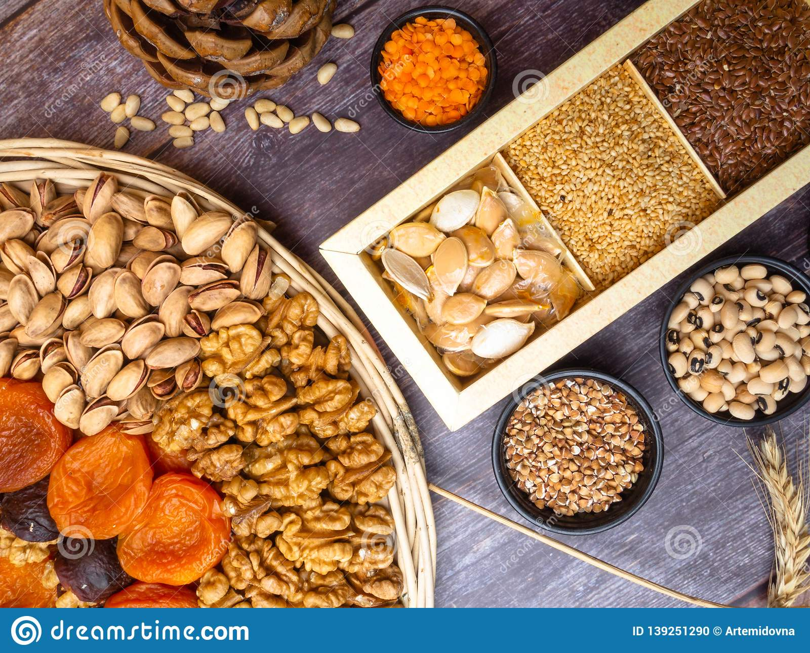 Vegan protein source. Beans, lentils, nuts and seeds. Top view on wooden table. Healthy vegetarian food
