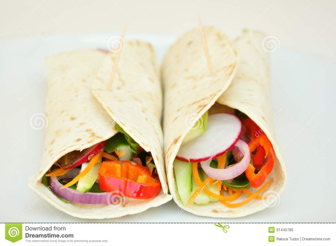 ... vegetarian burritos with tomato, onion, carrots, cucumber, radish