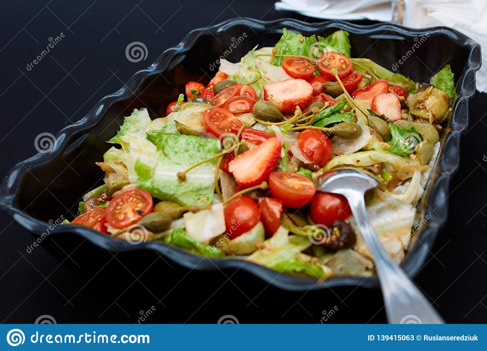 Vegetable salad made of tomatoes, lettuce leaves