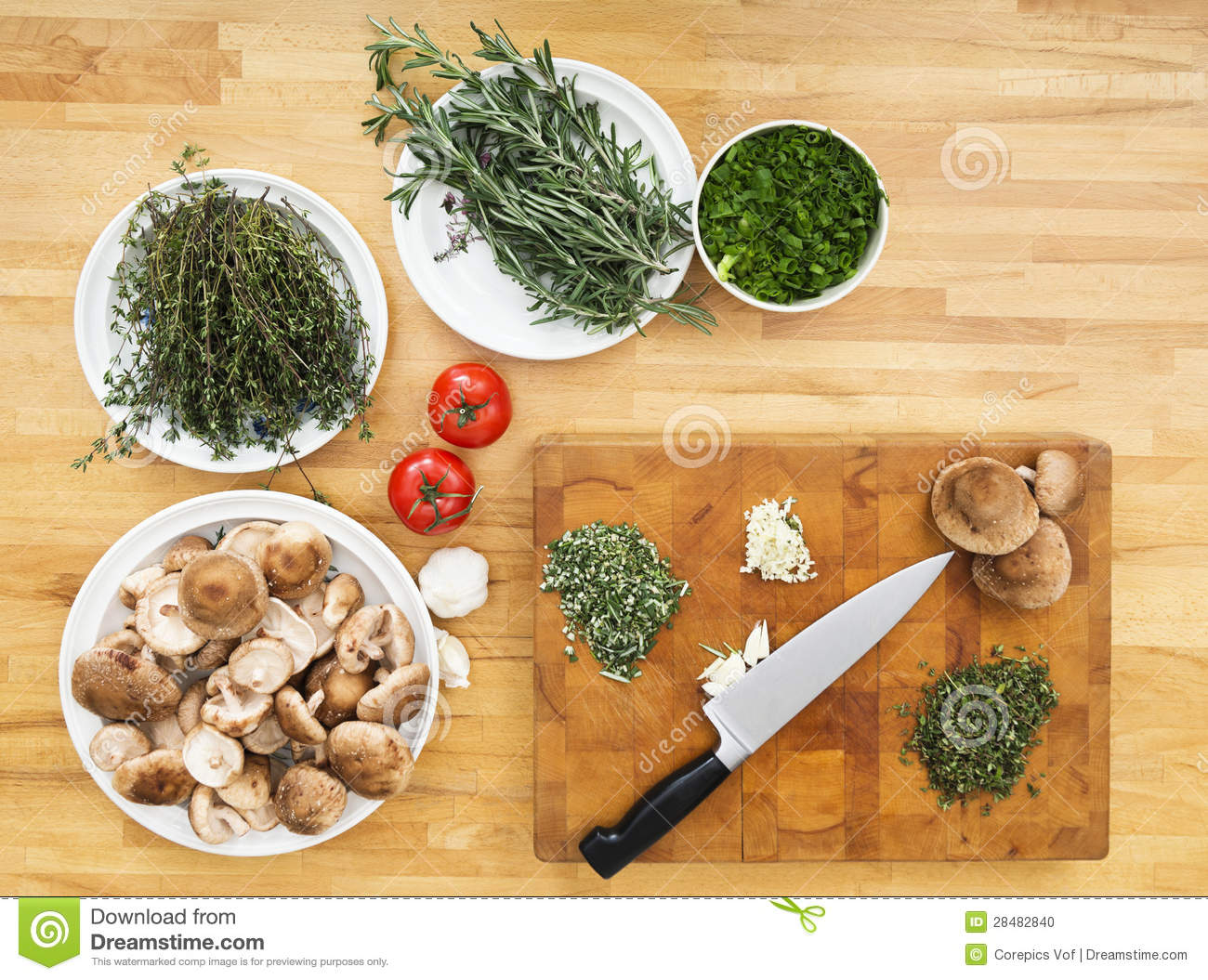 Vegetables And Chopping Board On Kitchen Counter