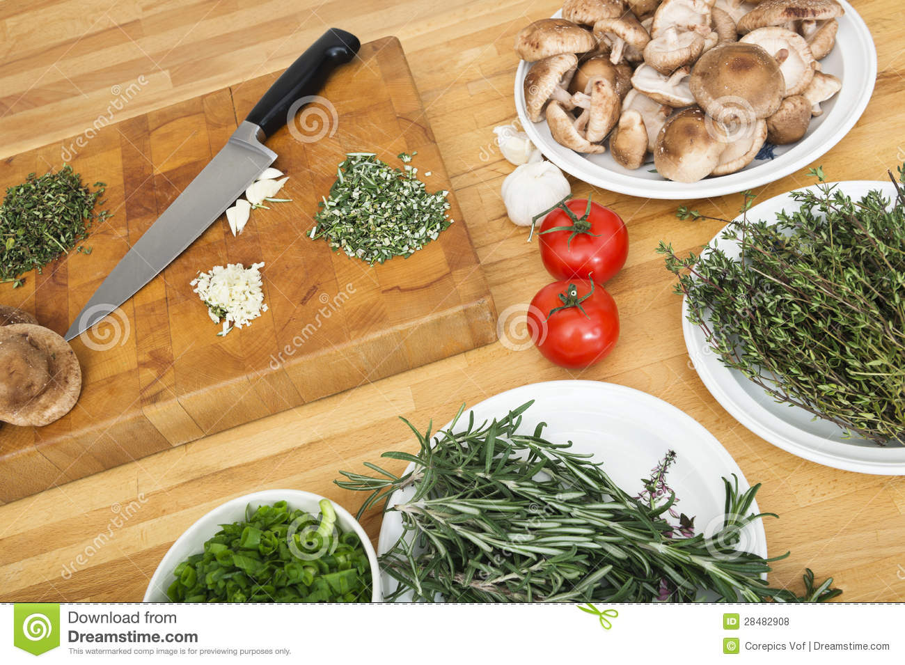 Vegetables With Chopping Board And Knife On Counter