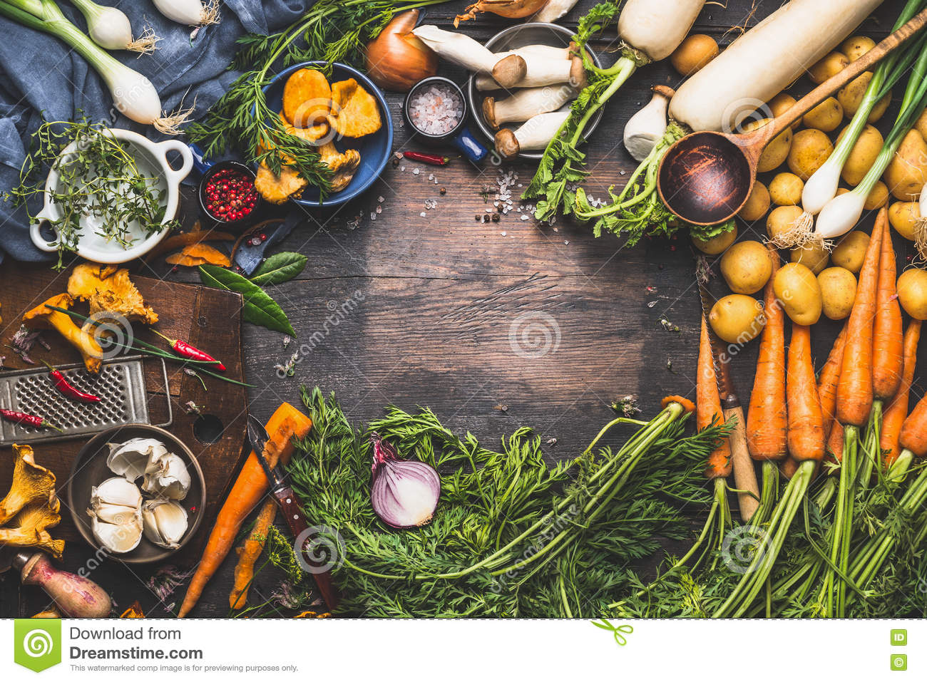 Vegetables cooking ingredients for tasty vegetarian dishes. Carrot , potato , onion , mushrooms , garlic , thyme , parsley on dark