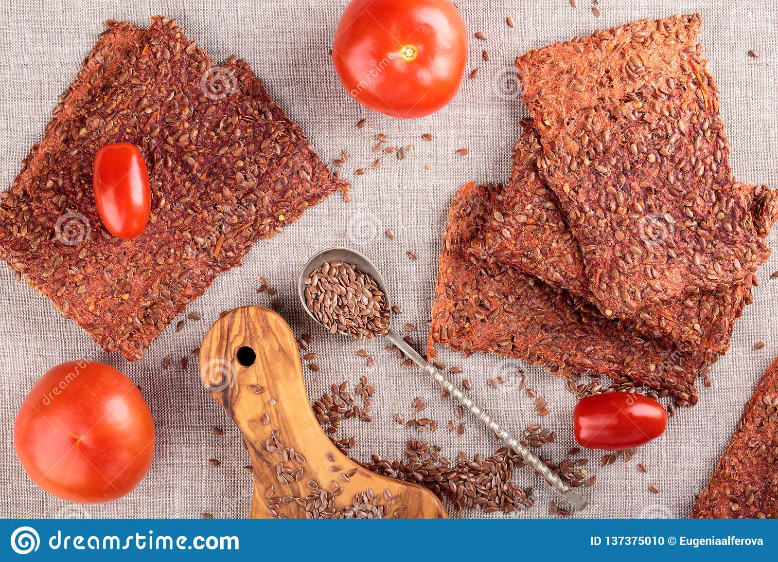 Vegetables crispbread crackers with flax seeds and tomatoes