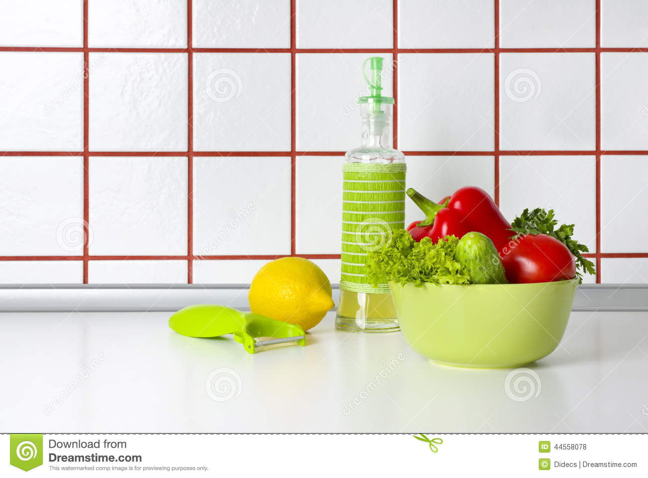 Kitchen Counter Background Vegetables Oil And Scraper On Kitchen Counter Background Stock