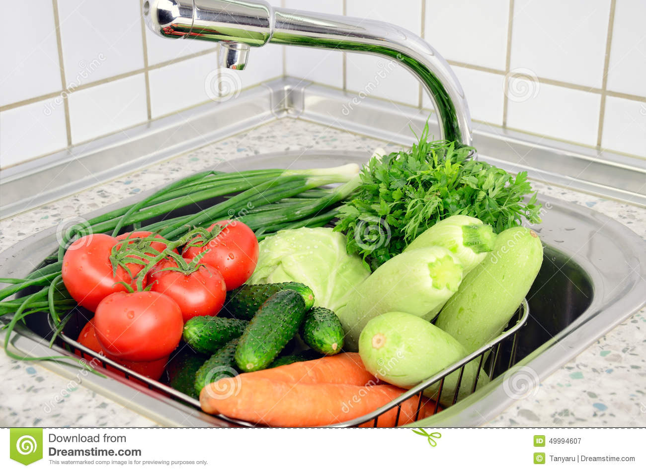 Vegetables In The Sink Under The Tap Stock Photo - Image: 49994607