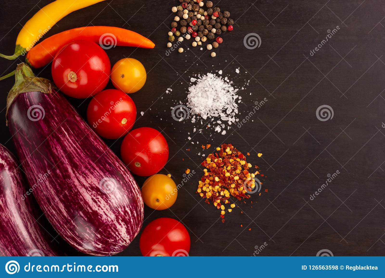 Vegetables and spices on dark board