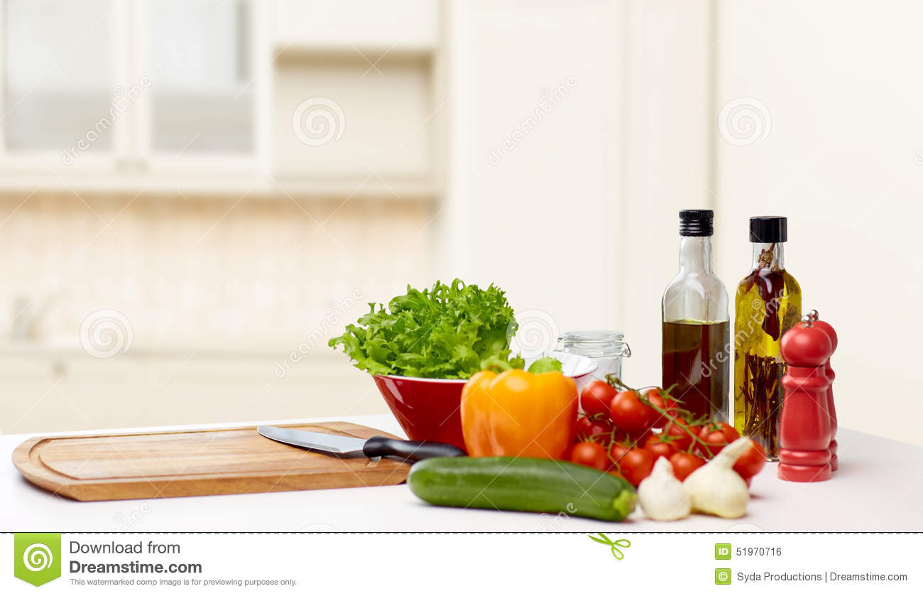 Vegetables spices and kitchenware on table stock photo for Eating table