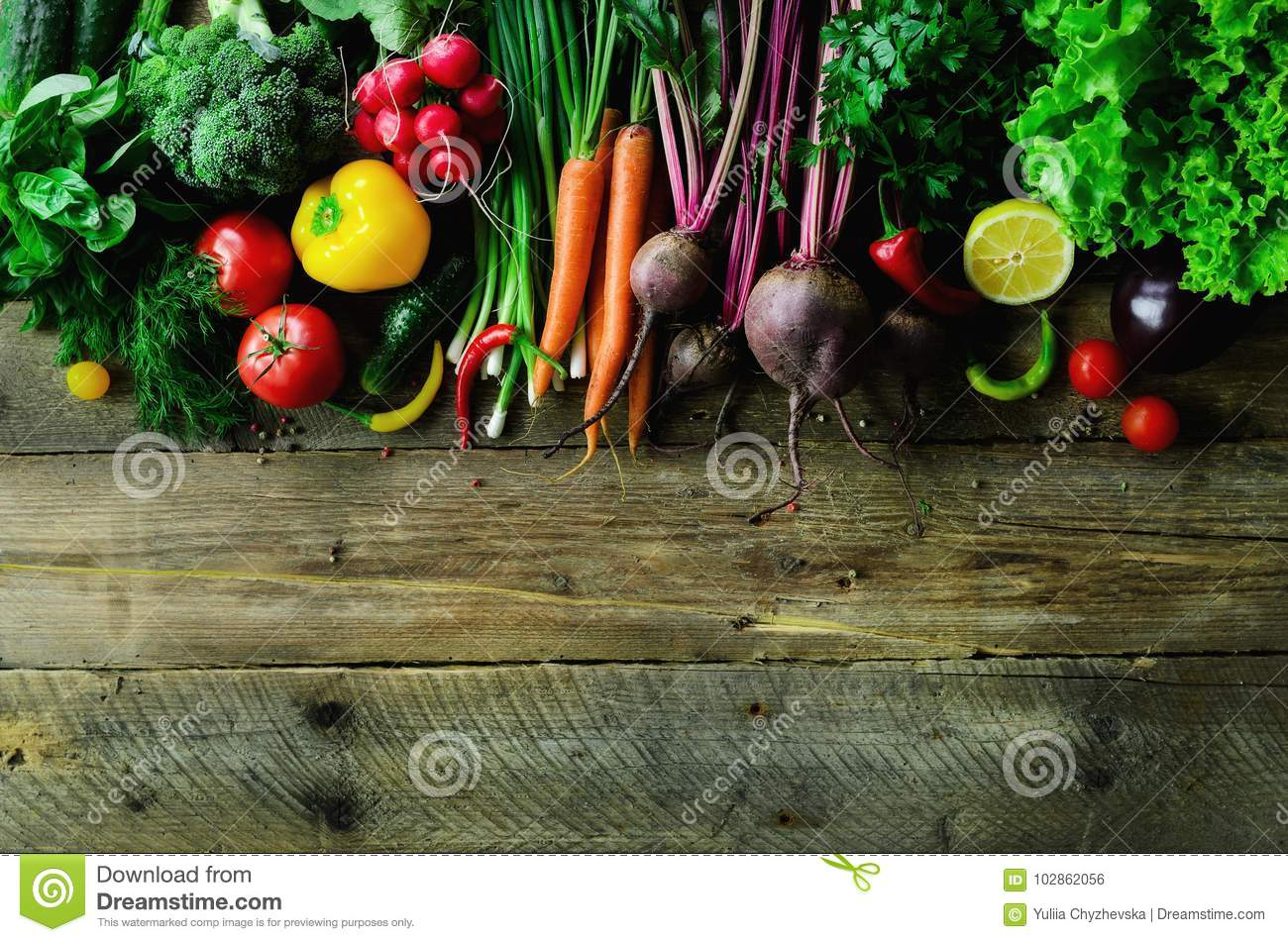 Vegetables on wooden background. Bio healthy organic food, herbs and spices. Raw and vegetarian concept. Ingredients