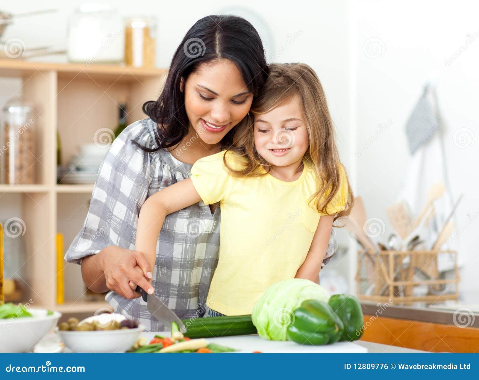 Vegetais louros da estaca da criança com sua matriz