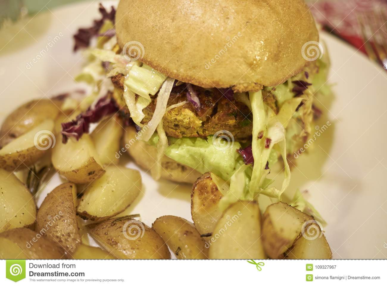 Vegetarian burger with roasted potatoes