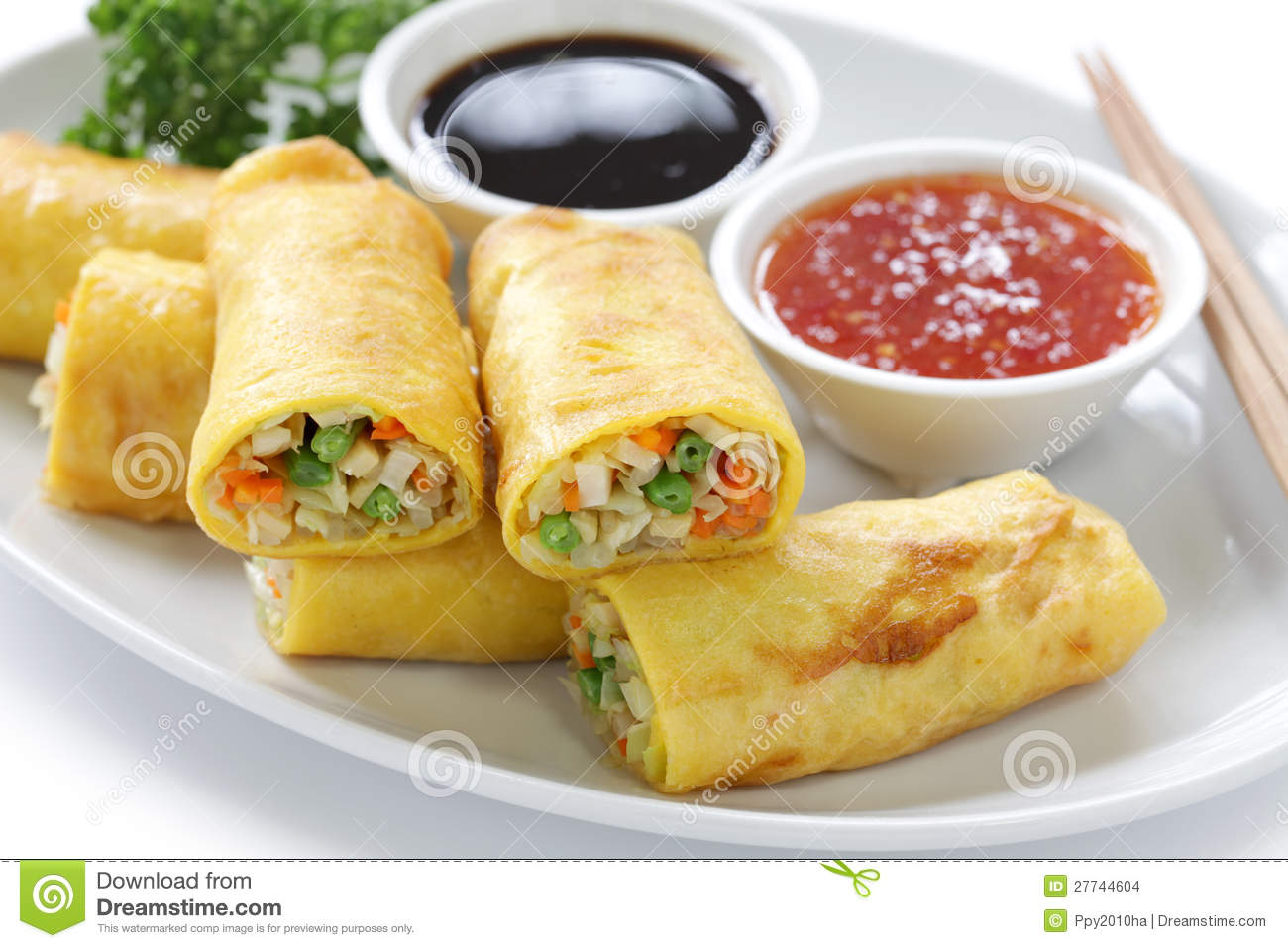Homemade vegetarian egg rolls on a white background.