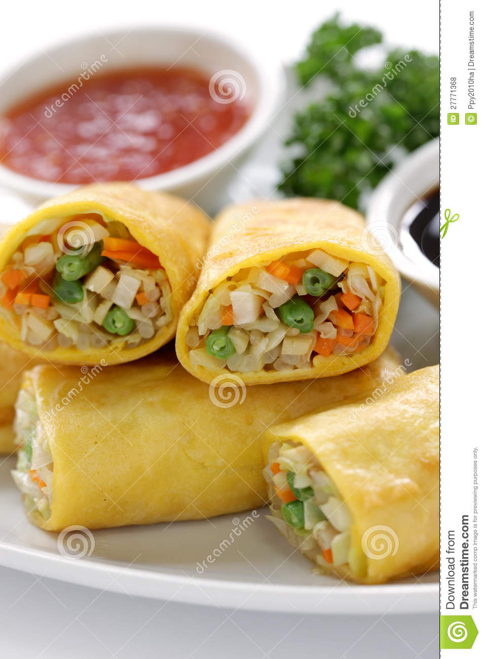 Homemade vegetarian egg rolls on a white background Vegetarian Egg Rolls