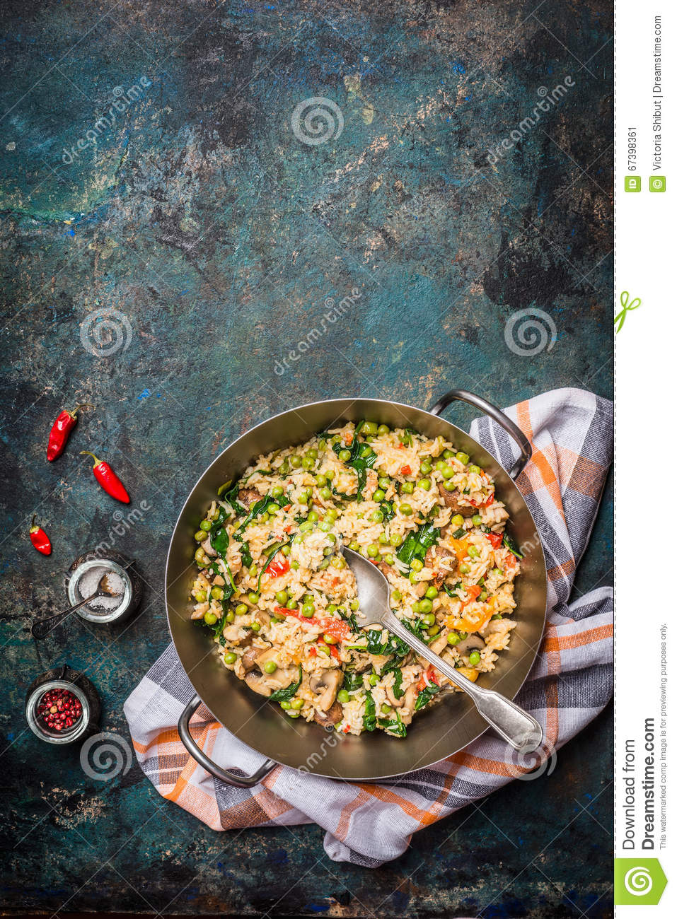 Vegetarian food background with rice vegetables dish and spices, top view