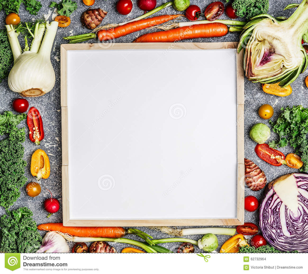 Vegetarian food, health and diet nutrition background with variety of fresh farm vegetables around a blank white chalkboard, top