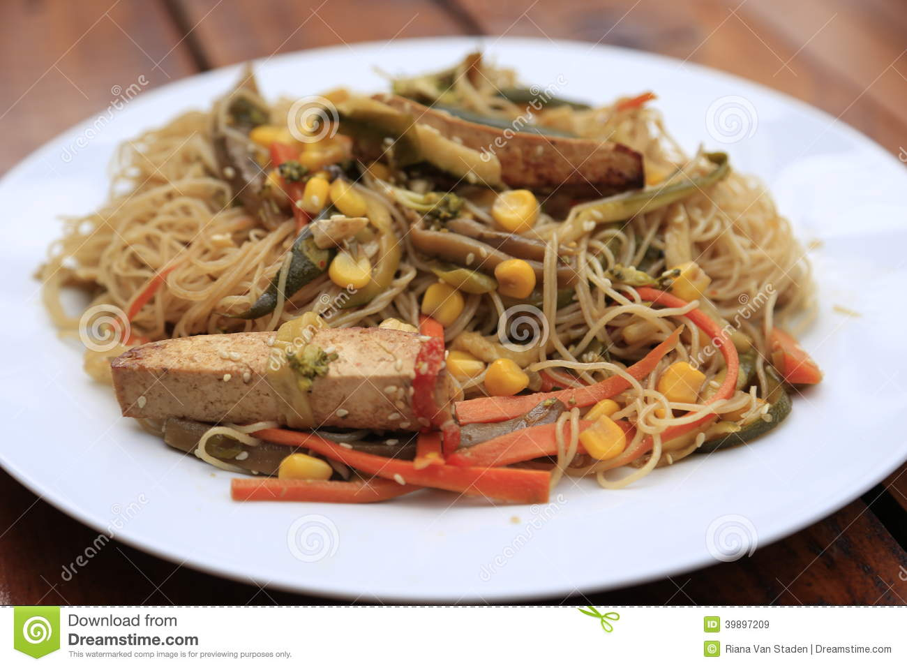Garden stir fry with rice noodles and tofu.