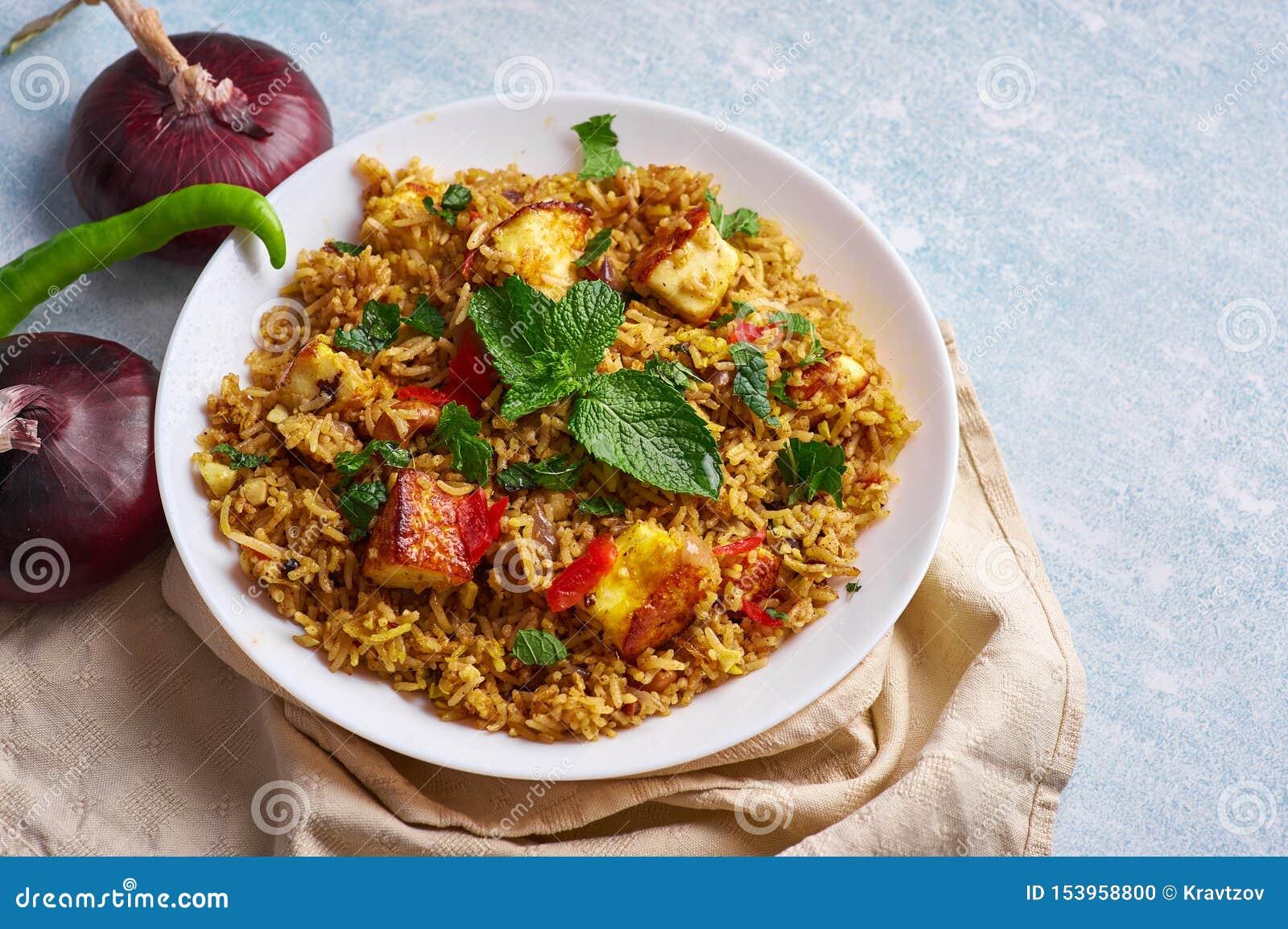Vegetarian Paneer Biryani At Light Blue Background Stock