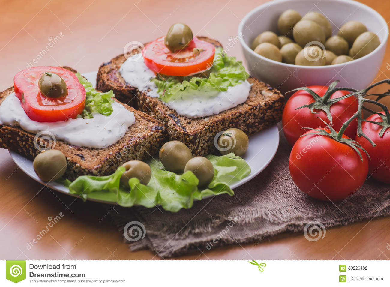 Vegetarian Sandwiches of homemade bread with cheese sauce or cream, lettuce
