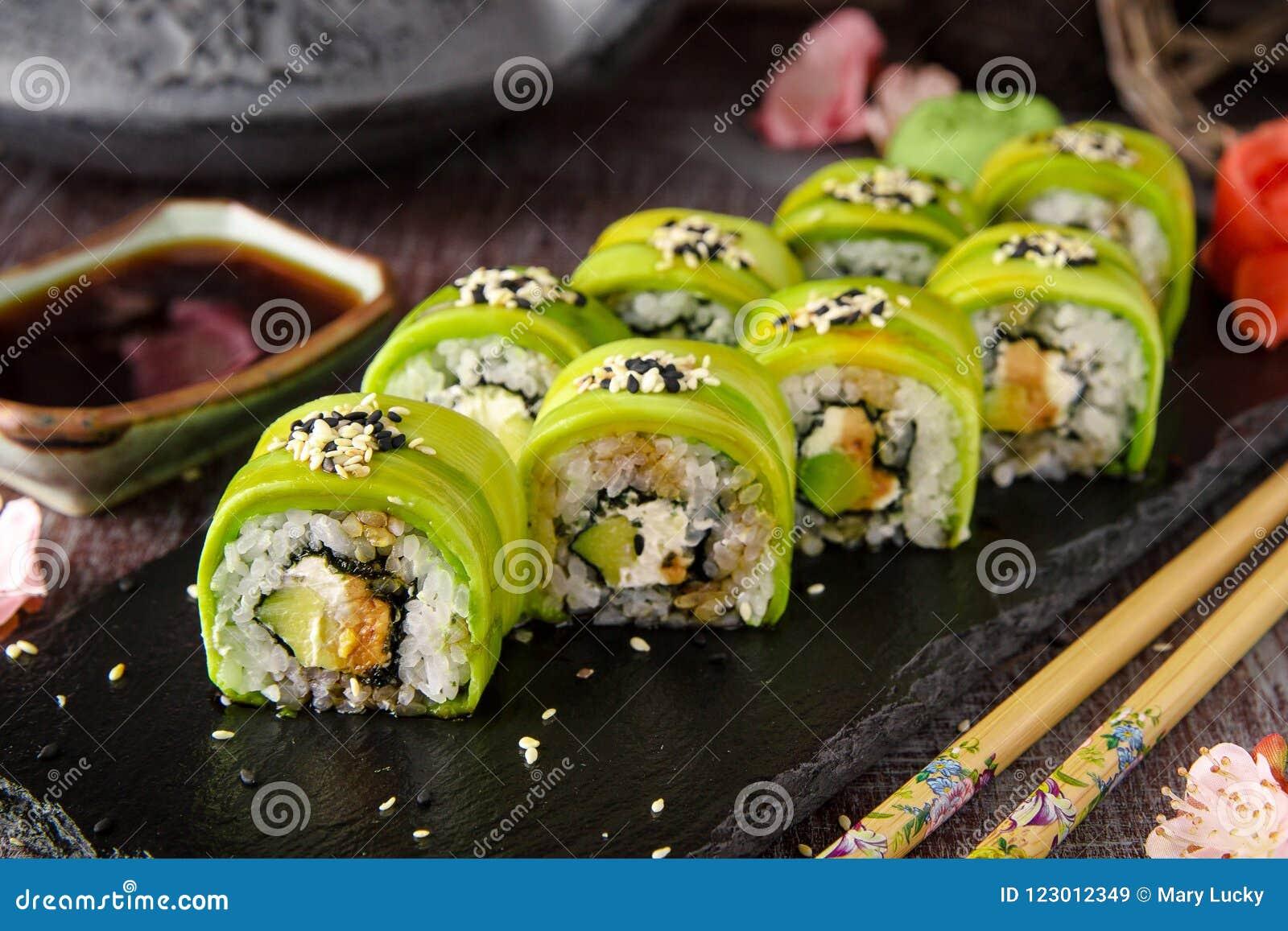 Vegetarian sushi rolls avocado with cream Philadelphia cheese, sesame, unagi sauce.
