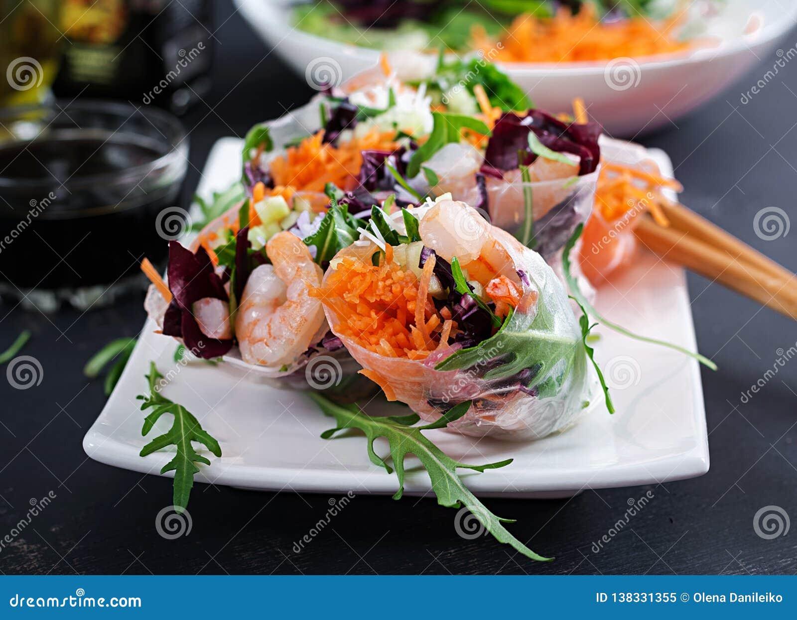 Vegetarian vietnamese spring rolls with spicy shrimps, prawns, carrot