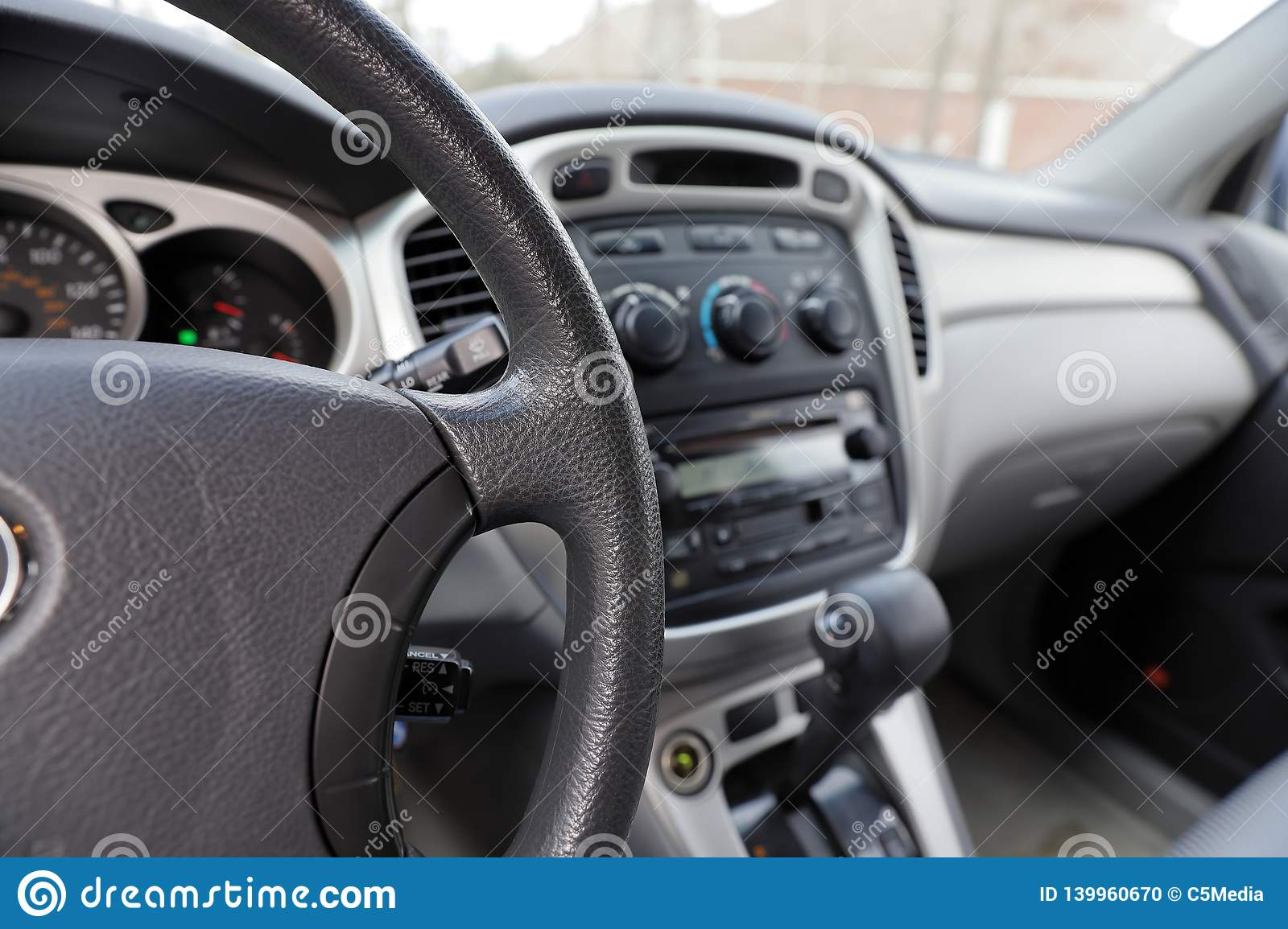 Automobile interior with steering wheel, gear shift and controls