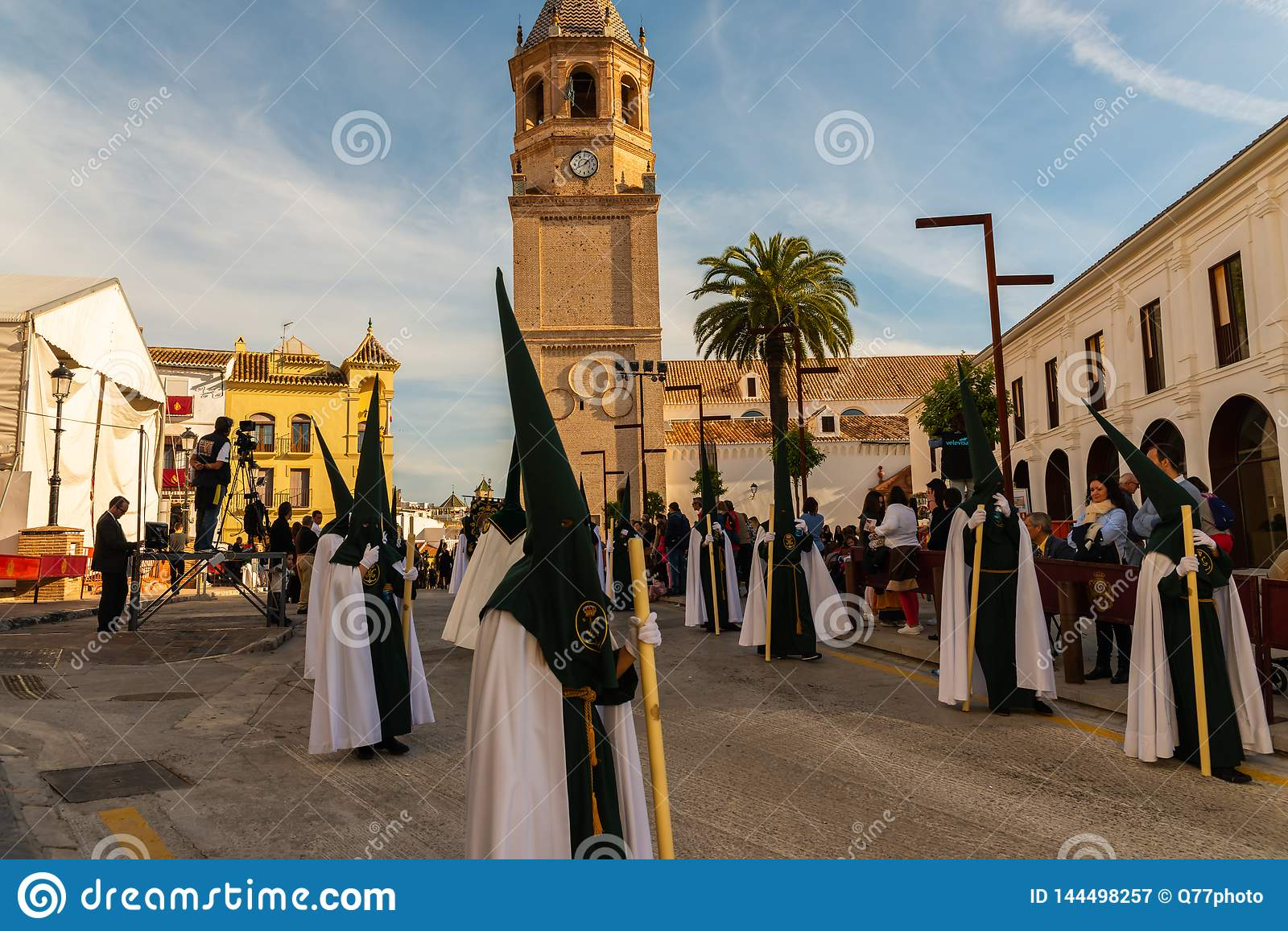 VELEZ-MALAGA, SPAIN - MARCH 29, 2018 People participating in the procession in the Holy Week in a Spanish city