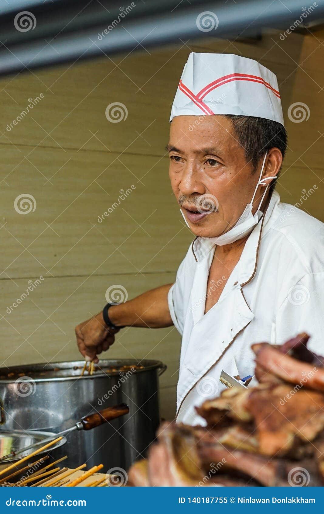 Vendedor de alimento da rua em Chengdu, China
