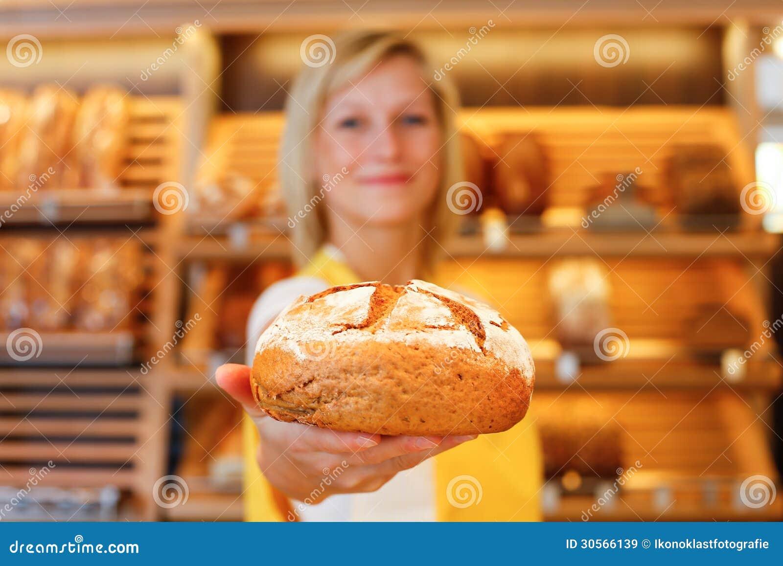 vendeuse de boulangerie avec la miche de pain image stock image 30566139. Black Bedroom Furniture Sets. Home Design Ideas