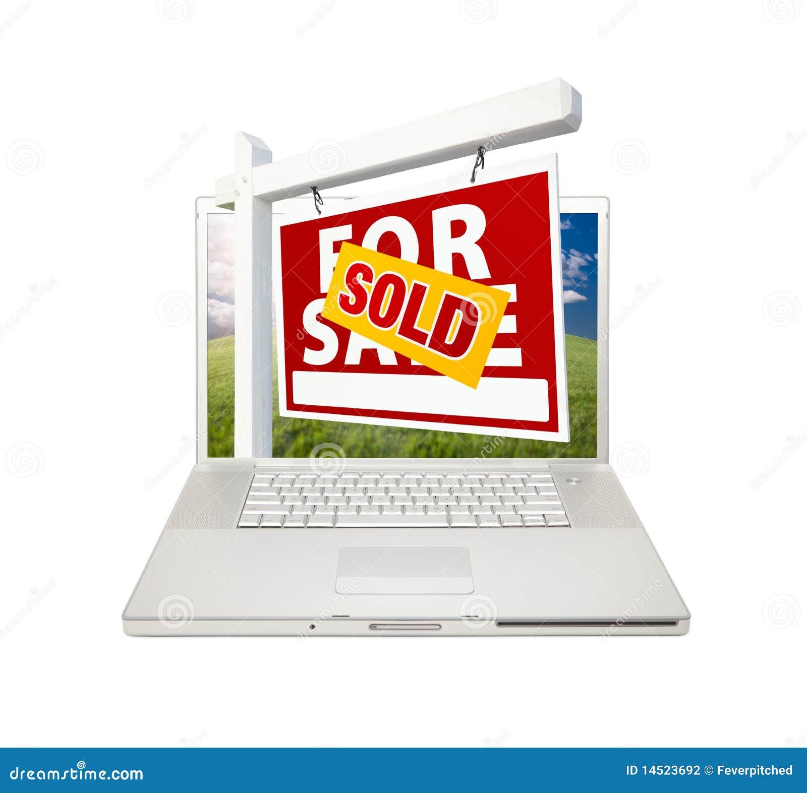 Vendido para la muestra de las propiedades inmobiliarias de la venta en la computadora portátil