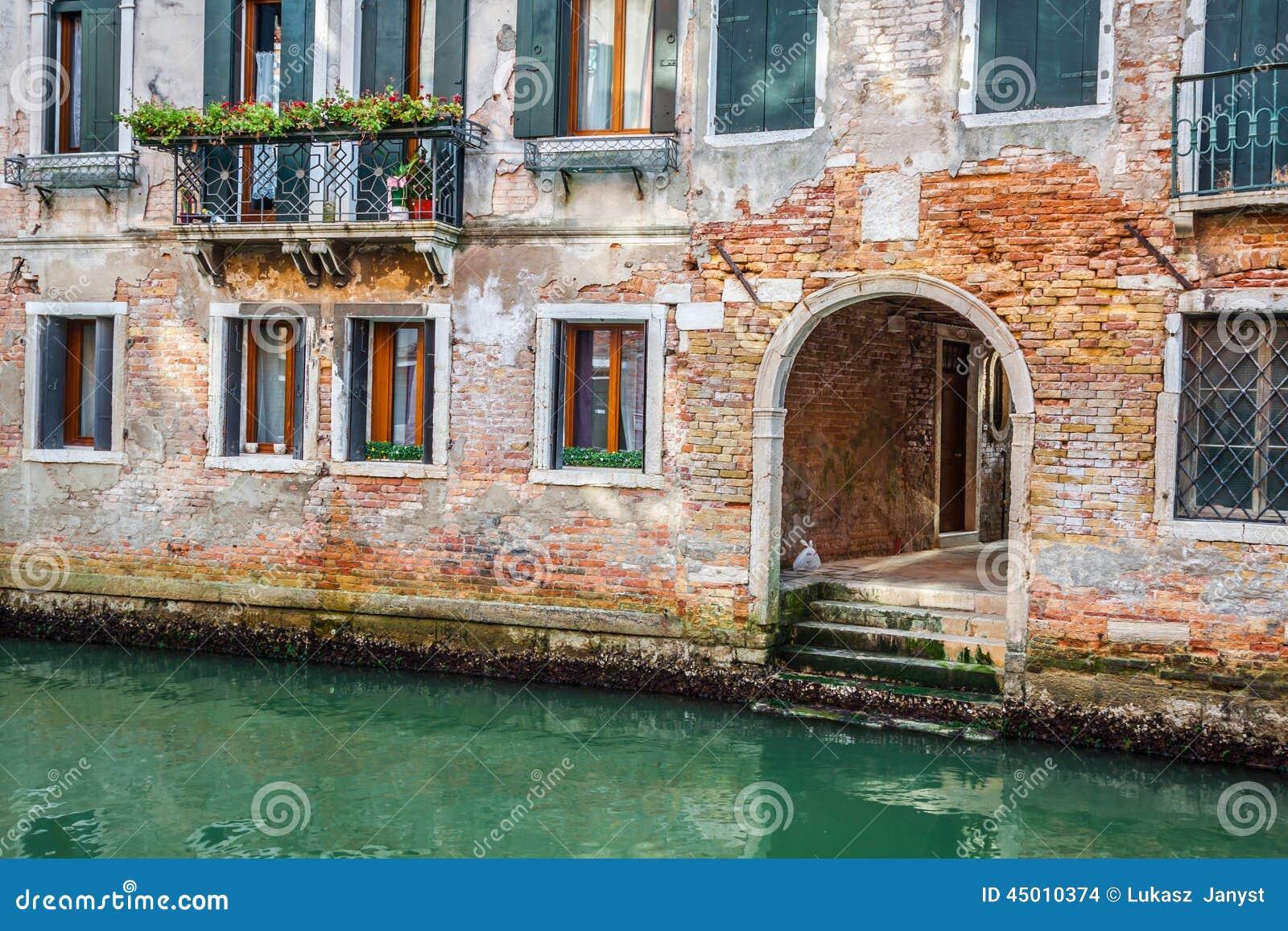 venetian buildings and boats along canal grande venice