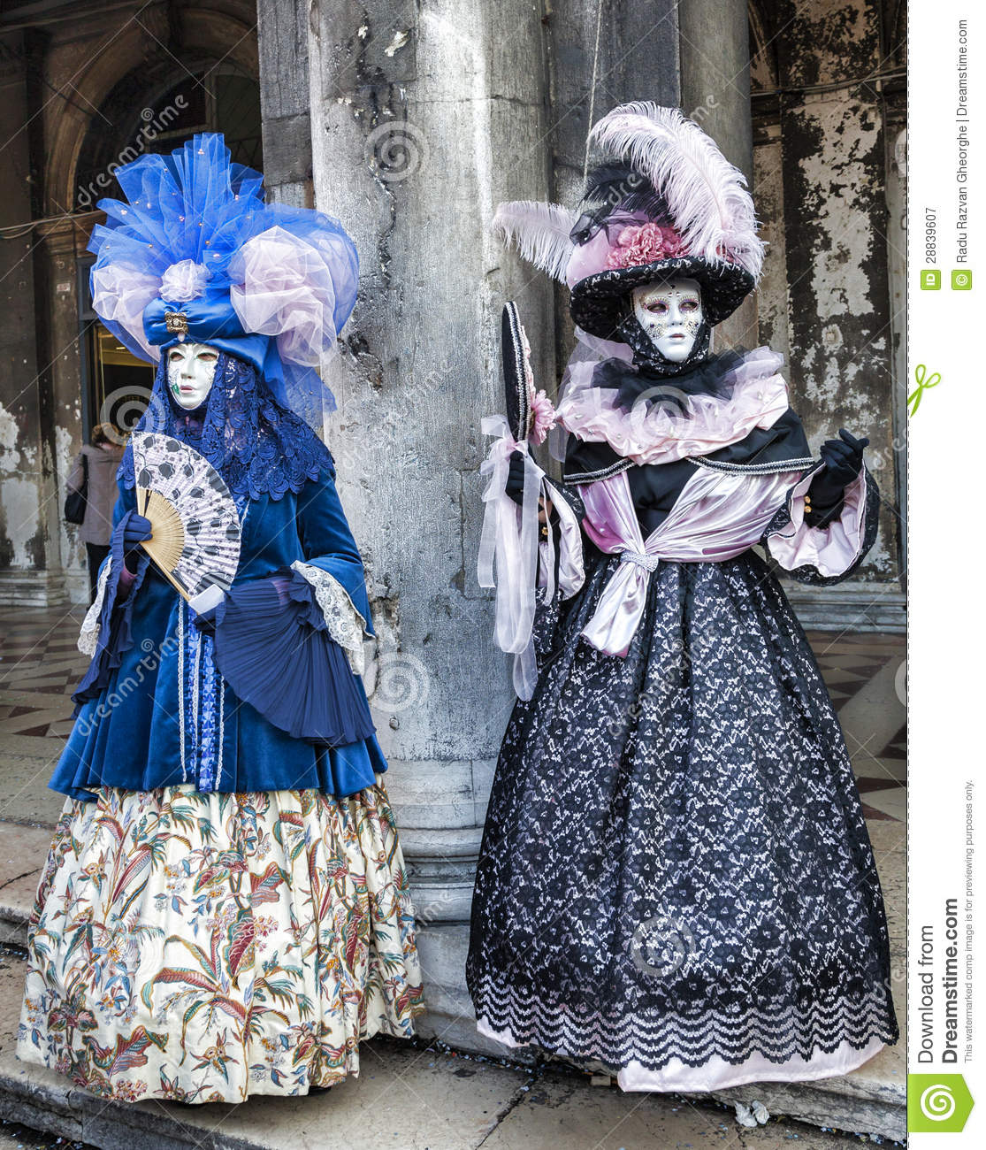 Venice, Italy-February 18,2012: Two persons wearing specific costumes ...